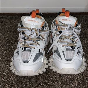 White and orange Balenciaga tracks.